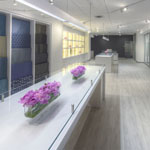 This 2,900 square foot showroom for a wallcovering and fabric supplier is designed to highlight their wide range of textures and materials.  A subtle color scheme created by white-washed plank flooring and white laminate millwork allows for the full expression of the continuously changing product lines.  Not only can the removable panel wallcoverings be updated seasonally, but the custom sliding track system was designed to create spatial flexibility as well.  An endless combination of panel layouts gives the showroom the ability to arrange comparisons for a particular client or built-in cabinets millwork details were also designed to provide future flexibility while providing the much needed storage for their vast catalog of textiles.